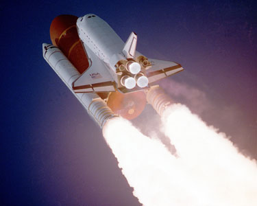 NASA Space Shuttle on rockets taking off into space