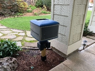 Drone mailbox example on front porch of a house